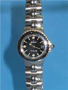 Movado Womens Olympian Watch Black Face Date Stainless