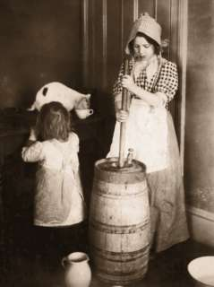 Woman Churning Butter Photographic Print at AllPosters