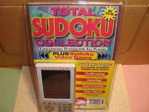 SUDOKU Electronic Handheld Video Game + Puzzle Book